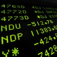 143308-a-board-at-the-new-york-stock-exchange-shows-the-final-trading-numbers
